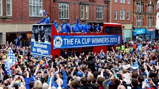 Wigan celebrate FA Cup win with parade shortly after Premier League relegation - video