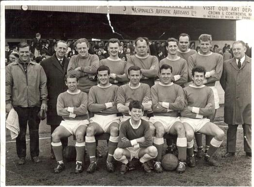 Wigan Athletic 1964-65. Back row, Wilf Birkett (Trainer),  Les Jackson (Chairman), Alan Halsall, Roy Wilkinson, Alf Craig, Ralph Gubbins, Derek Houghton, Derek Crompton, Frank Latham  Front Row: Les Campbell, Carl Davenport, Harry Lyon, Allan Brown (Player Manager), Walter Stanley