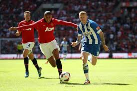 McClean and Smalling compete for the ball