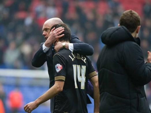 Rosler consoles Gomez after penalty miss.  Thanks to Latics Officlal for the photo.