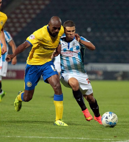 A return to form for captain, Emmerson Boyce. Photo courtesy of the Huddersfield Examiner.