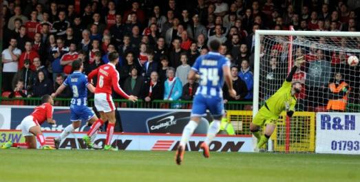Will Grigg scores the first goal. Photo courtesy of the Swindon Advertiser.